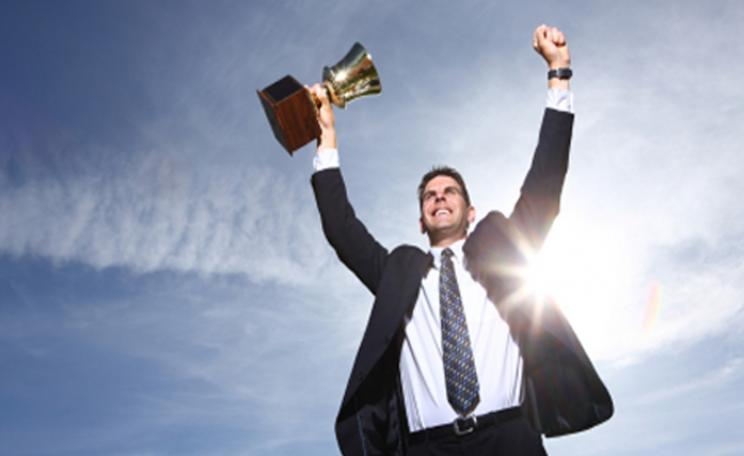 A businessman celebrates a win