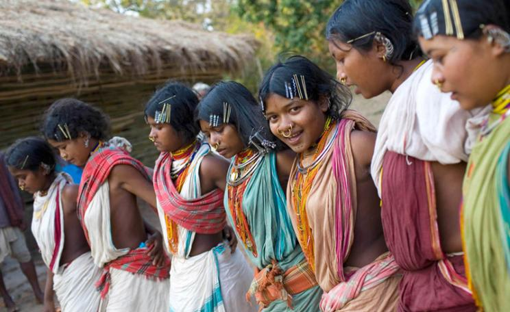 17 year old, Almay (3rd from right) dances with other tribal girls during the mass worship in Ijurupa village near Vedanta refinary in Orrisa. Indigenous communities conduct the worship, which is an annual feature, in their respective states, but this yea
