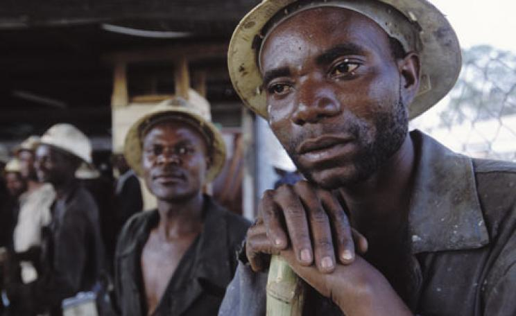 Copper mine workers at NFC Africa Mining shaft in Chimbishi