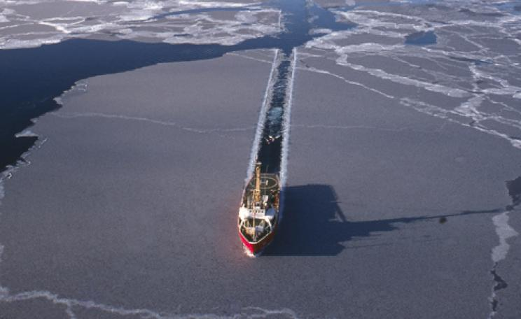 A ship breaking through Arctic ice