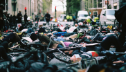 Photograph of cyclists laying in the road at a Stop Killing Cyclists protest