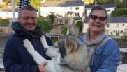 From left to right: Wayne Dixon, his dog Koda, and Annabel Tarrant