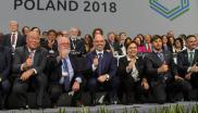 Diplomats and minsters pose for photographers at the close of Cop24