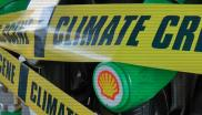 Shell petrol pumps covered in 'climate crime scene' tape