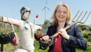 MP Liz Truss with wind turbine at the Family Action's Escape Allotment in Swaffham. Photo: Matthew Usher / edp24.co.uk/.