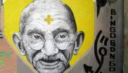 Mahatma Gandhi remains a potent symbol of freedom from the oppression of colonialism and overweening corporate power. Photo: wall in Berlin by Marius Watz via Flickr (CC BY-NC-SA).