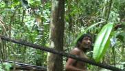 Still from video footage taken by a Brazilian government task force during a chance encounter with a Kawahiva tribe member in his rainforest home. Photo: FUNAI.