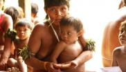 Returning hair samples to a Yanomami community after testing for lead content. Photo: © Marcos Wesley / ISA.