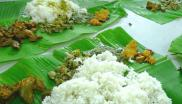 Most rice-eating peoples like their rice white - and will avoid yellow rice as the colour is an indicator of the deadly mould that causes beri-beri disease. Photo: rice and curry on banana leaf in Riau, Indonesia, by John Walker via Flickr (CC BY).