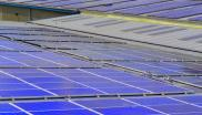 Wall to wall solar panels on industrial buildings in Birmingham, UK, where the Aurora report was published this week. Photo: h080 via Flickr (CC BY-SA).