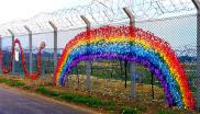 Rainbow-decorated fence at Greenham Common US military base near Newbury, England, 17th March 2007. Photo: Your Greenham via Flickr (CC BY-NC-SA).