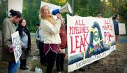 A woman shouts into a megaphone at a tar sands blockade in Canada (c) Laura Borealis